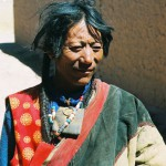 A nomad of western Tibet wearing a celestial metal amulet