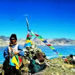 Erecting prayer flags at the heart of Lake Nam Tsho