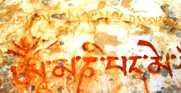 "Fig. 8: The first five syllables of the six-syllable mantra of the Bodhisattva of compassion, Che letters were boldly written in deep red ochre. The initial syllable Om with its superscribed tripartite vowel and consonant sign represents an obsolete calligraphic flourish. This paleographic trait suggests that the mantra was written prior to 1300 CE. As for a terminus a quo, a date before 1000 CE is not likely, because there is little archaeological evidence for a strong Buddhist presence in the Changthang prior to that time. Even more interesting is the upper inscription scribbled in orange-red ochre. This mantra belonged to a non-Buddhist cult (or perhaps more aptly, a pre-Buddhist cult) of Upper Tibet, which can be labeled 'Bon' in the most inclusive sense of the word. It reads: ""A A A dkar sal le 'od A (followed by two or three largely illegible syllables that should read: yang Om' 'du)"". This is the first part of the well-known mantra of Kuntu Sangpo (Kun-tu bzang-po), the primordial Buddha of the Great Perfection (Dzokchen, rDzogs-chen) tradition, a profound system of mind training and metaphysical speculation. This sacred ejaculation is supposed to have been first recited by Tonpa Shenrab, the legendary founder of the Eternal Bon religion. It is also worth pointing out that the letter A in Dzokchen represents the primal ground of consciousness. The terminus ad quem of this inscription is circa 1250 CE but it could actually be considerably earlier. In Tibetan literature, Bon and Buddhist Dzokchen are traced to the early historic period (Bonpos hold that it was even practiced in prehistoric times, but this cannot be conclusively established). Despite Kuntu Sangpo also being a deity of Tibetan Buddhism, this non-Buddhist mantra appears to have been deliberately smudged, as probably were other pigment applications underneath and adjacent to Chenresik's mantraenresik (sPyan-ras-gzigs), are visible in this image."