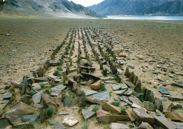 Fig. 2:  A dense array of standing stones with the faint remains of an appended edifice in the foreground. Discovered in 1999, this site is located in northwestern Tibet. The field of standing stones is in surprisingly good condition