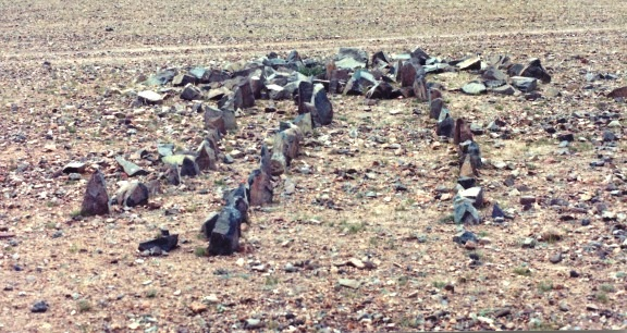 Fig. 4: An especially small example of a concourse of standing stones photographed in 1999. It is comprised of just three short rows of stelae, and while there may possibly have been one or two additional rows originally, this was a minor site. Very little of the diminutive appended temple-tomb has survived