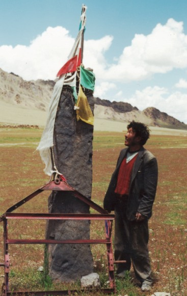 Fig. 13. At 2.4 m, this is the tallest pillar of its kind discovered in Upper Tibet. Reportedly, the enclosure and several other large well-hewn pillars were destroyed in the Chinese Cultural Revolution during a failed agricultural project.