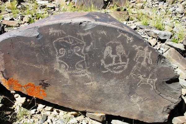 Fig. 14. Two later mascoids found at the epicenter of this genre of rock art. The shallow carving and style of companion animals indicate that this is another example of protohistoric period rock art. The artist was savvy enough to create his mascoids in both major head shapes: circular and rectangular.