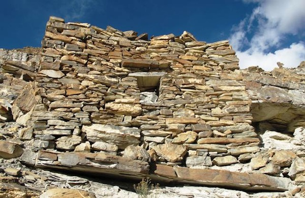 Fig. 11. The forward wall (2.1 m high) of the highest elevation individual residence at the site. It has been designated DK1. This small building (3 m x 1.7 m) was built into the layered rock of the formation. The window opening (40 cm x 35 cm) is supported by a stone lintel. However, on its interior side several small rounds of tamarisk (?) were added to the lintel assembly.