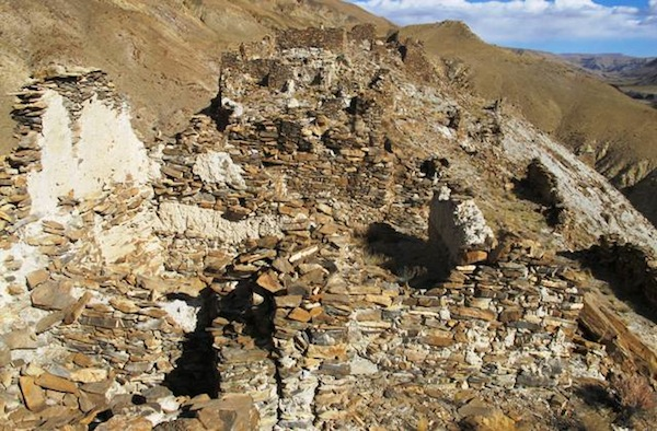 Fig. 3. A view to the east overlooking the ruins in sectors IV and V of the citadel. Note the light-colored clay-based mortar used in the seams of the walls. There is also a longitudinal upper wall segment made of this same material (right foreground), a highly unusual structural material. This type of wall could only have supported a lighter roof made of wooden members.
