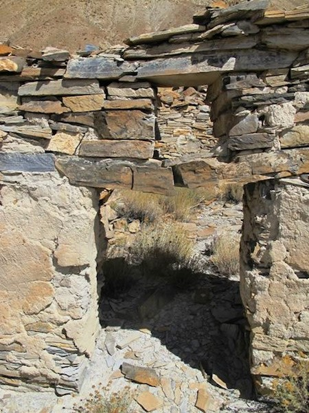 Fig. 6. An entranceway (90 cm x 60 cm) connecting two rooms in Sector I. This is one of the only entrances that remains intact in the ruined facility. The lintel (1 m long) has broken in half. Above it is an aperture (35 cm x 30 cm) with its own lintel. Doorways are typically small in the all-stone corbelled architecture of Upper Tibet. Much of the clay-based plaster is still affixed to the walls.