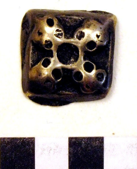 Fig. 3. A similarly designed object of the Tibetan amulet group known as thokcha (thog-lcags), 2.5 cm in width. Private collection, photograph by author.