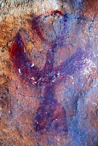 Fig. 2. A red ochre raptor with prominent horns found at a newly documented rock art site, eastern Changthang.  This pictograph (20 cm in height) has undergone much wear and geochemical change necessitating rigorous digital enhancement in order to fully appreciate its beauty.
