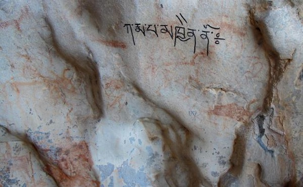 Fig. 5. While it is admirable to see Tibetans expressing their religious sentiments, this recent writing of a mantra (ka rma pa mkhyen no) over ancient art is decidedly unsuitable in its choice of locations.