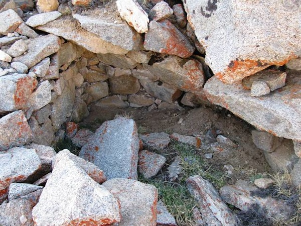 Fig. 6. A small fragment of the stone roof adhering to a rear chamber in DK4. Note how this room is now mostly filled up with earth and rubble.