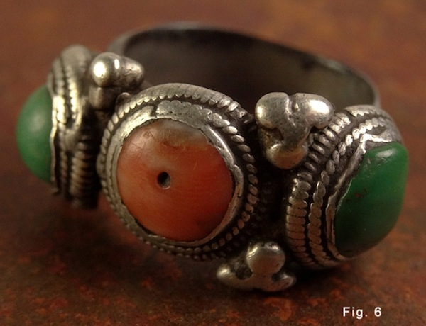 Fig. 6. Old silver ring inlaid with turquoise and coral cabochons. Collected in eastern Tibet. Many damaged beads were often given a new lease of life by using them as cabochons in jewellery.