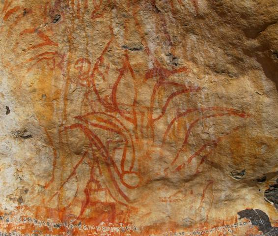 Fig. 10. What appears to be the flaming jewel motif on the right side of the panel. This graceful and quite beautiful red ochre depiction of a sacred symbol important to both Bonpo and Buddhists is juxtaposed against other pictographs. Note the curling tongues of fire rendered as if the rock itself was aflame.