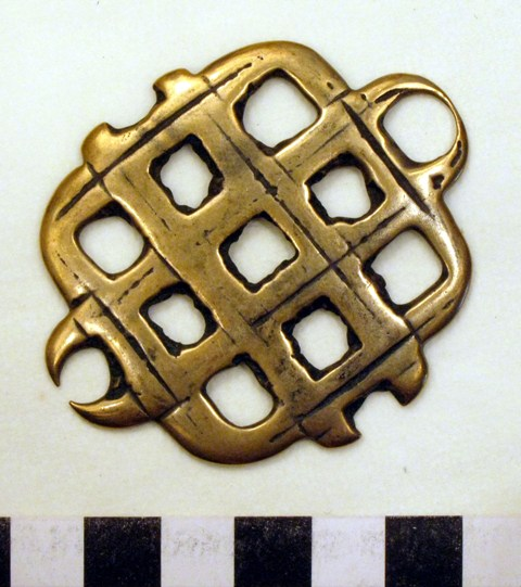Fig. 4. A copper alloy thokcha endless knot of the same style as the pictographic example. Two of the four outer rings have almost entirely worn away. Probably manufactured sometime between 900 and 1400 CE, this popular style talisman must have been used by Tibetans of all sectarian orientations. The endless knot is still highly regarded as an auspicious symbol by both Bonpo and Buddhists. Private collection.