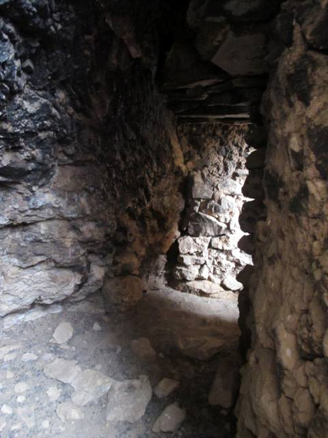 Fig. 15. The interior of the cave. The entranceway in the north specimen of the twin chortens is visible in the background. Note the corbelled stone ceiling.
