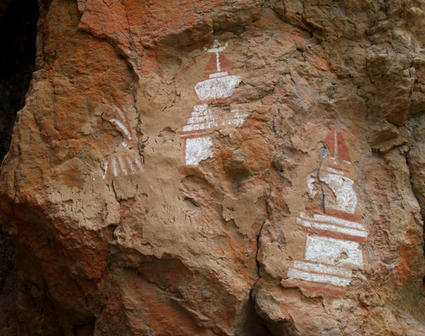 Fig. 16. The three main pictographs rising above the stone and mortar chortens, consisting of a stylized handprint (?) and two chortens.