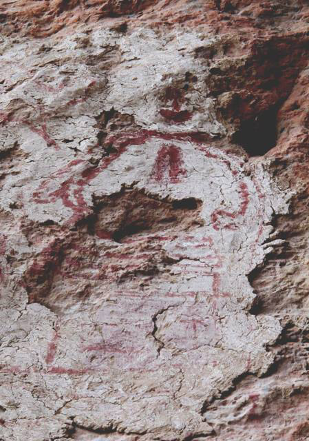 Fig. 20. A highly deteriorated chorten painted on mud plaster adhering to the rock wall.
