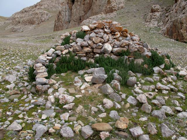 Fig. 24. One of the cubic shrines on the valley floor below the Churo formation. It has been reduced to not much more than a pile of rubble.
