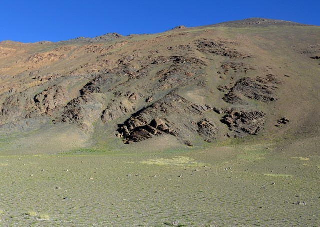 Fig. 1. The mountain of Thakhampa Ri. The rock art site is the dark pyramidal outcrop near the base of the mountain (middle of photograph).