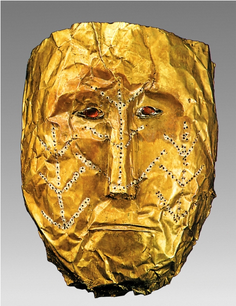 Fig. A. Golden funeral mask of a woman with tattoo-like decorations which represent the trees of life. These decorations were created by puncturing on the reverse and covering with white paint on the obverse. Rouran period, 5th–6th century CE. Excavated in 1958 in Shamsi, Chui Province, Kyrgyzstan. Caption and photo courtesy of Dr. Christoph Baumer. Photo credit: National Historical Museum of Kyrgyzstan, Bishkek.