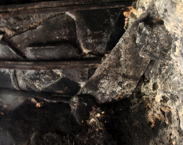 Fig. 11. Detail of the roof in another middle room of the original Kyisum Labrang. Note the corbels and bridging stone on the right side of the image. The roof is composed of wooden rafters sheathed in small, fire-blackened stone slabs. It is not clear which room/rooms functioned as the chapel in the original Kyisum Labrang. However, it is likely to be this one or the one in figs. 9–10.