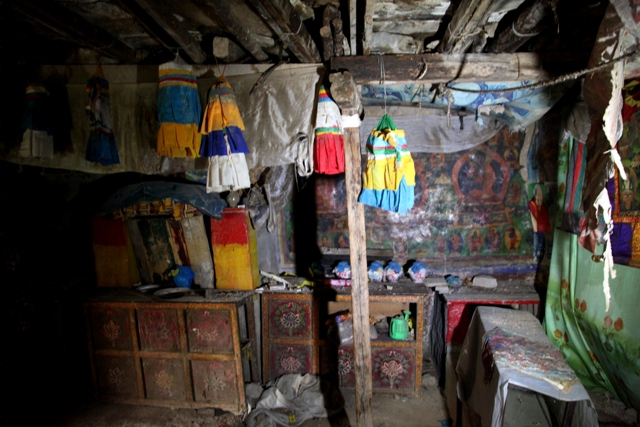 Fig. 17. The interior of the Kyisum Labrang chapel. The religious articles and scriptures in this chapel are hardly used anymore. Damage from leaks in the roof imperil its continued existence.
