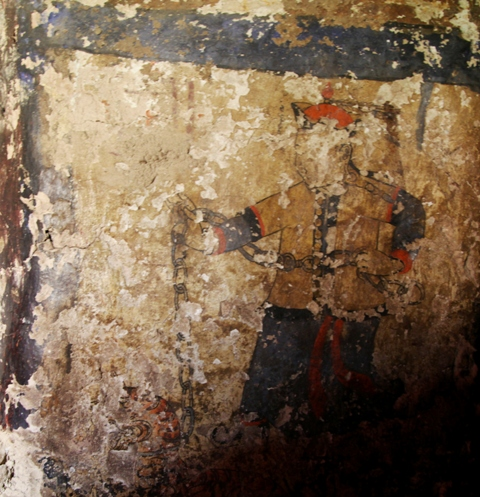 Fig. 19. Fragment of an older mural near the entranceway of the chapel in the current Kyisum Labrang. This wall painting depicts the bodhisattva of compassion in the guise of a Mongolian, who holds a tiger by a chain (symbolizing the other two major bodhisattvas), a common entranceway subject in Buddhist monasteries as well. I think this art was painted circa the second half of the 17th or first half 18th century CE, but I am not certain.