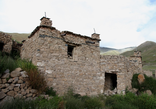 Fig. 6. A well-designed house of the central complex, Kyisum village. Although centuries-old, this structure with its windows and wooden lintels belongs to a later phase of house construction in the central complex. Older structures stand behind it. Like other residences of old Kyisum village, this house lies forlorn, having been vacated eight years ago. In the fierce climate of the Changthang, it does not take long for buildings to give way to the elements.