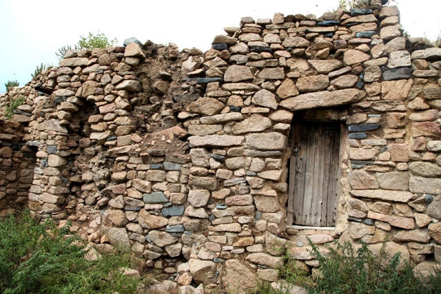 Fig. 7. The facade of one of the buildings at the original Kyisum Labrang. Note the large slabs of stone in the walls and the stone lintel over the diminutive entranceway.