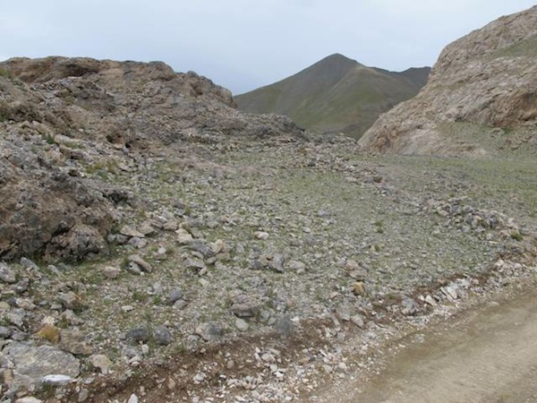 Fig. 12. Ancient rampart traces at Khyung La, Lake Dangra. With the new road, cultural and environmental impacts are likely to increase, as they do virtually everywhere in the world when a new road is cut through a remote location.
