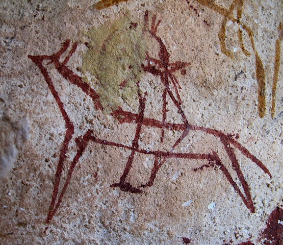 Fig. 8. A red ochre mounted archer (much of the bow has been obscured) hunting a wild yak. It is located in the same small cave as fig. 7. Late Bronze Age or Iron Age, eastern Changthang.