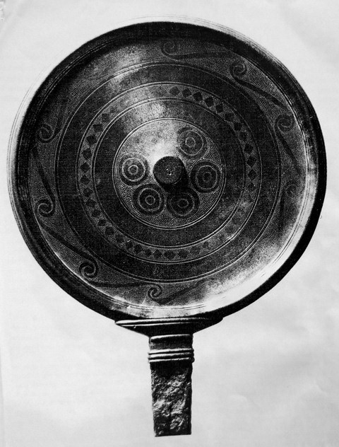 Fig. 6. A Tibetan engraved copper alloy mirror with volutes of the Ruthok animal style in the outer ring. Iron Age or early Protohistoric period. Former collection of the late Namgyal G. Ronge. Digital image after Ronge 1998 (see below for bibliographic details).
