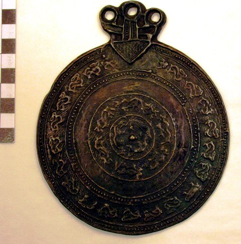 Fig. 7. A copper alloy mirror (melong) embossed with three concentric bands of animals. The mirror is 13 cm in diameter. Iron Age or early Protohistoric period. Private collection.