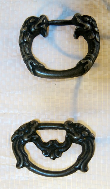 Fig. 115. Two copper alloy buckles or rings for attachment, with a pair of confronting fish. Early Historic period (650–1000 CE) or Vestigial period (1000–1300 CE). Tibet Museum collection.