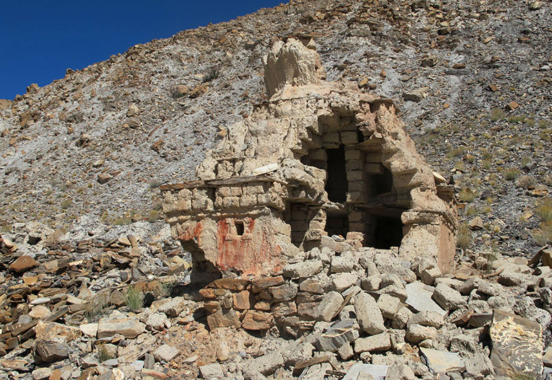 Fig. 23. One of a number of chorten thoroughly opened up and cleaned out by treasure hunters, who apparently were able to work with impunity over a number of days, Dar-skam, 2011.