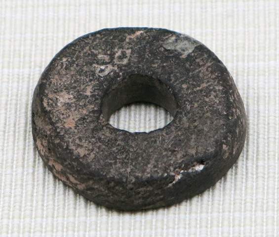 Fig. 36. Stone spindle whorl, Chugong, Lhasa. Late Neolithic (4000–3500 BP). Tibet Museum collection.