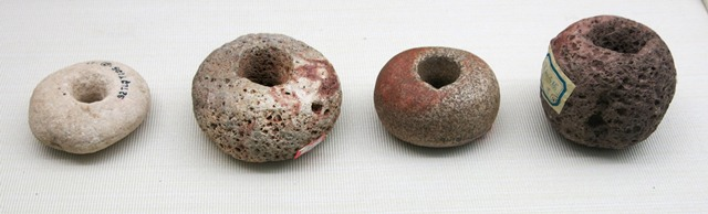 Fig. 39. Stone balls with hole in middle of unknown function, Kharub, Chamdo. Middle or Late Phase of Neolithic (5300–4000 BP). Tibet Museum collection.