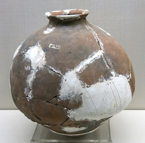 Fig. 61. A globular jar of yellowish-brown ware, with incised geometric decorations on the body, truncated neck, rounded lip and sub-conoidal base. Kharub, Chamdo, Middle or Late phase of the Neolithic (5300–4000 BP). Tibet Museum collection.