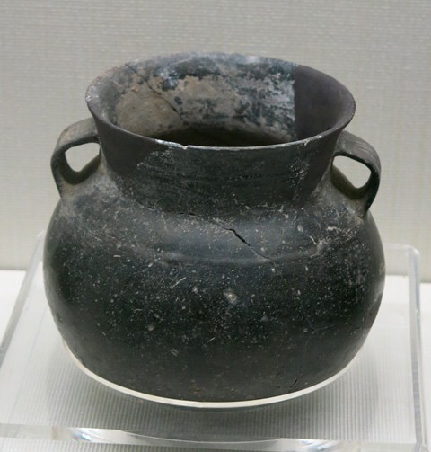 Fig. 79. A burnished dark-gray globular jar, with wide, outwardly tapering neck, attenuated lip, and two strap handles. Chugong, Lhasa, late Neolithic (4000–3500 BP). Tibet Museum collection.