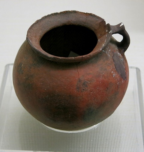 Fig. 85. A circular red ware cup, with almost straight walls and ring handle with thumb rest. Chugong, Lhasa, pre-Imperial period. Tibet Museum collection.