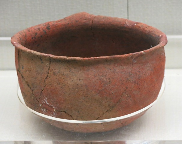Fig. 88. A deep bowl of red ware, with an everted rim, and what appears to be a single handle in the rear. Chugong, Lhasa, pre-Imperial period. Tibet Museum collection.