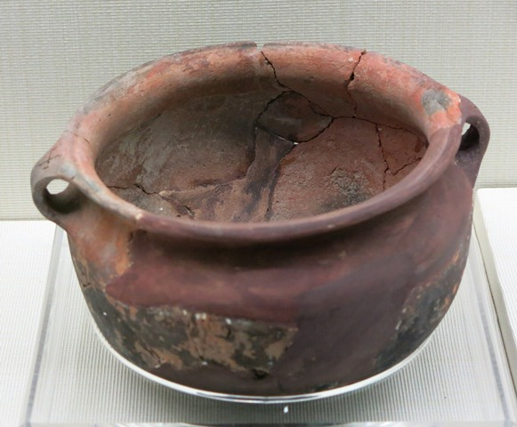 Fig. 92. A wide-bodied jar of red ware, with sloping shoulder, turned-out rim and two lug handles. Chugong, Lhasa, pre-Imperial period. Tibet Museum collection.