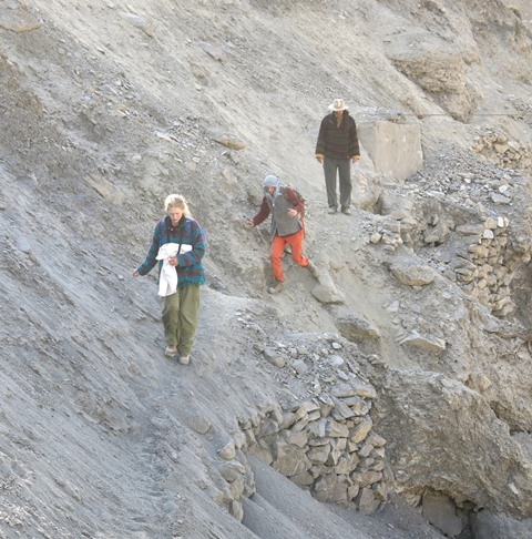 Fig. 6. Members of the SAE crossing a damaged section of trail on the way to a rock art site