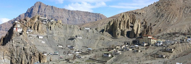Fig. 17. The modern monastery at Dankhar (large yellow building on the right side of the photograph) and the old monastery in the crags (left side of the image).
