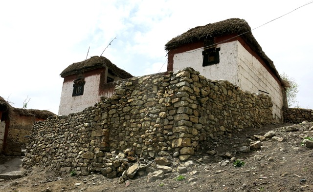 Fig. 17. The south and east sides of the Tenzin Tsultrim residence, Key village. The high walls in front of the house enclose a courtyard where sundry domestic functions take place.