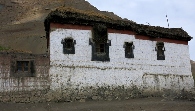 Fig. 18. The north side of the Tenzin Tsultrim residence, Key. Note the different-sized windows, each with complex denate lentils. Above the band of red ochre is a tamarisk cornice and above that brush is stacked on the roofline.