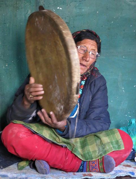 Fig. 24. Iphi Tshering Gadrup singing and playing her tambourine, Gungri village.