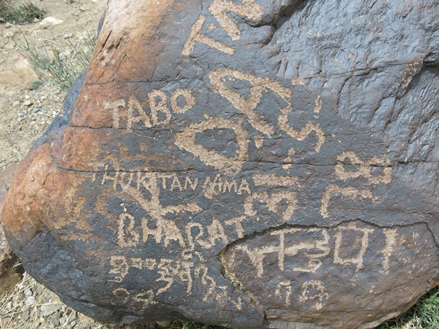 Fig. 21. Ancient rock art recently defaced by graffiti, Tabo.