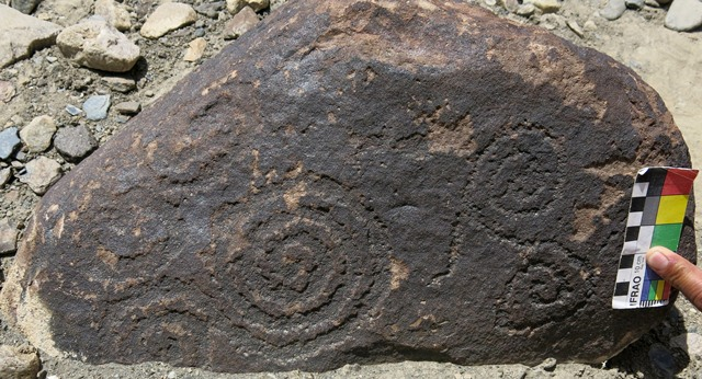 Fig. 75. Two scrolls on small boulder, Gyari. Iron Age.