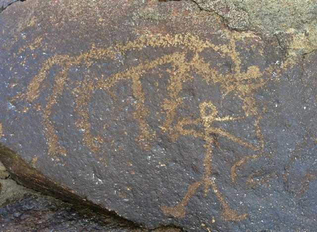 Fig. 9.4. A standing male archer with what appears to be a wild yak above. This composition is located on the same boulder as fig. 9.2. Protohistoric period.