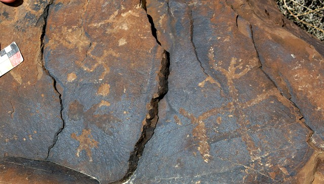 Fig. 14.31. Anthropomorph with arms raised and widely spread legs (right). Early Historic period. On the left side of the boulder are two clockwise swastikas and star (bottom) that can also be dated to the Early Historic period. Above the star there is an older petroglyph resembling an anthropomorph.